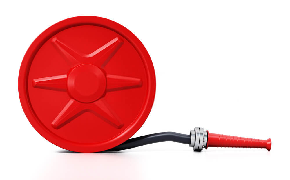 What are the advantages of a retractable hose reel compared to other types